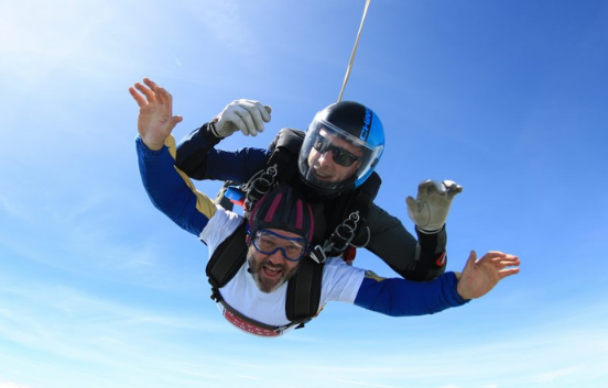 Two men fundraising through a skydive